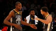 Kevin Durant #35 and Stephen Curry #30 of
