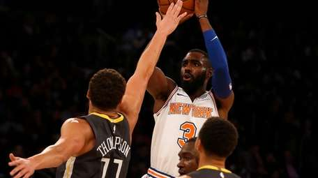 Tim Hardaway Jr. shoots over Klay Thompson during