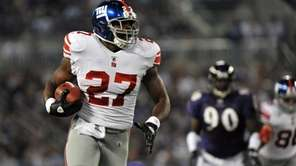 Giants running back Brandon Jacobs carries the ball