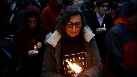 Mourners gather at a vigil Saturday night after