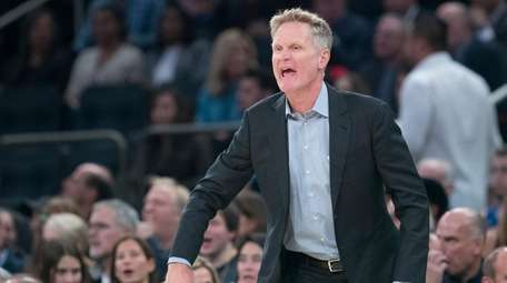 Golden State Warriors head coach Steve Kerr reacts