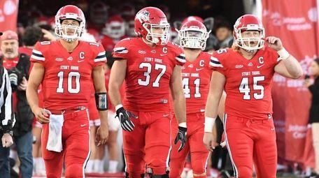 Stony Brook football captains walk onto the field