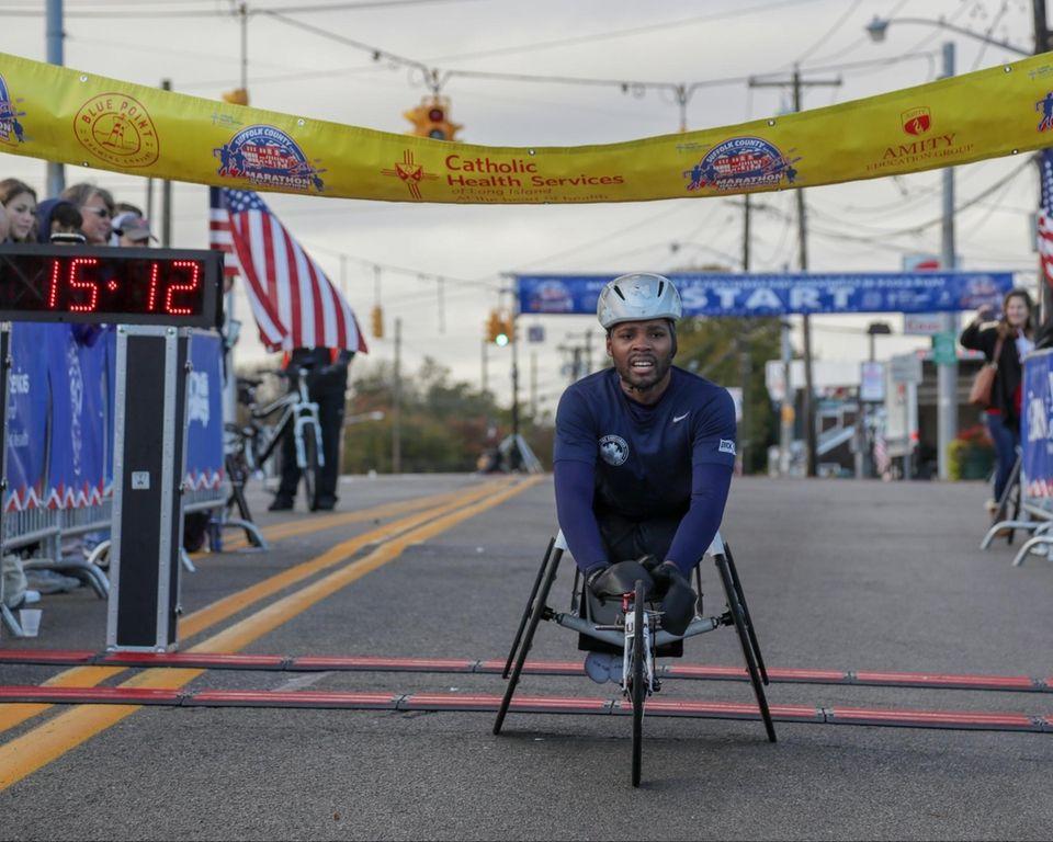 5K wheelchair race winner Mark Braun crosses the