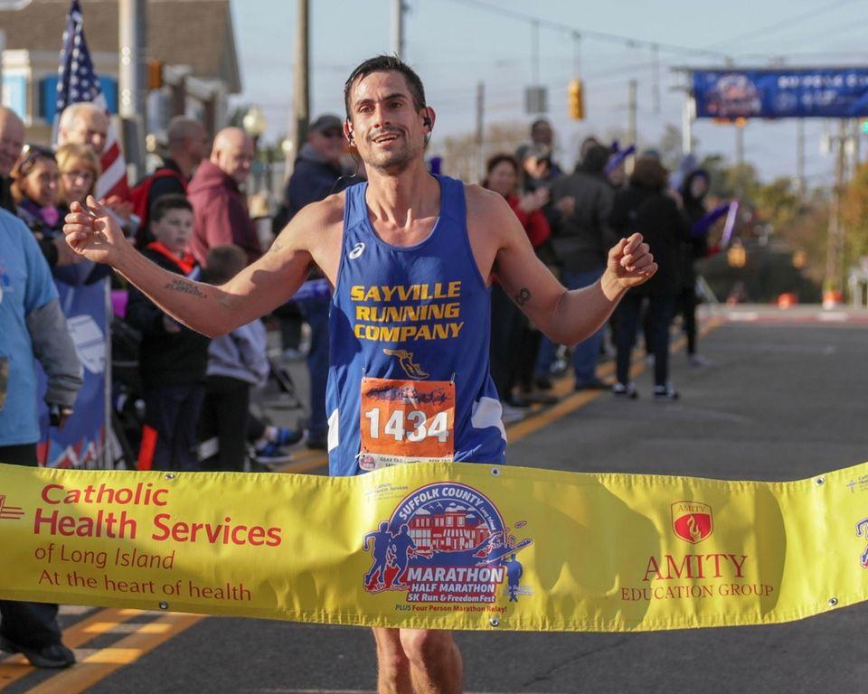 Jonathan Toro of Mastic crosses the finish line