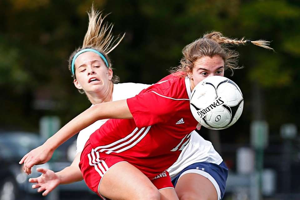 Kendall Halpern #12 of Syosset battles for the