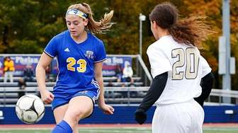 Emma Terino #23 of East Meadow plays the