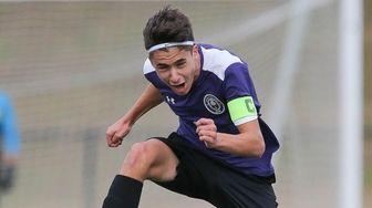 Greenport's Jacob Kahn (9) plays the ball during