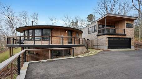 This .67-acre Hampton Bays property has a two-car