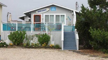 The 4,356-square-foot Westhampton Beach corner lot has private