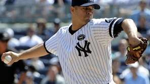 New York Yankees pitcher Javier Vazquez delivers to