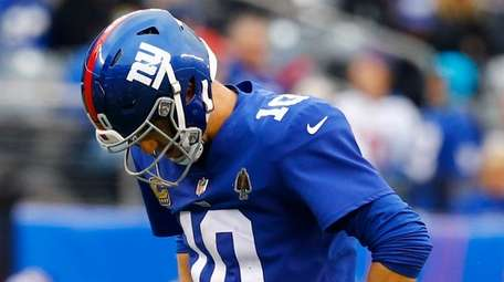 Eli Manning of the Giants reacts after being