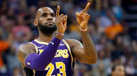 Lakers forward LeBron James celebrates a basket against
