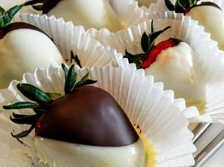Strawberries dipped in chocolate were a specialty at
