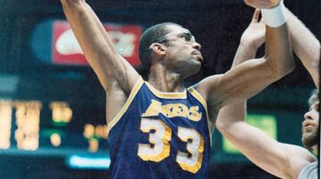 The Lakers' Kareem Abdul-Jabbar takes a hook shot