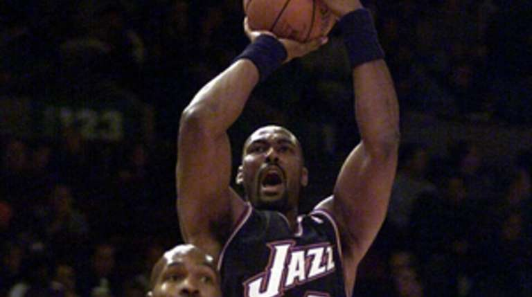 Karl Malone of Utah shoots in the first
