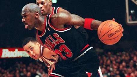 The Bulls' Michael Jordan drives past the Knicks'