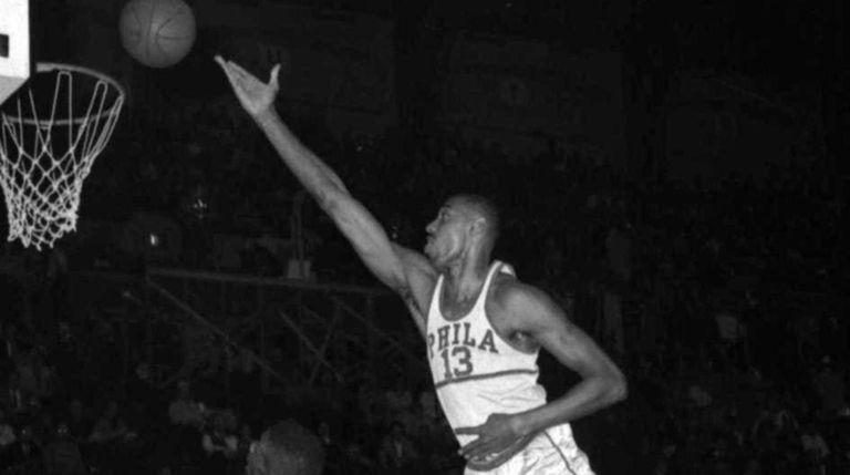 The Philadelphia Warriors' Wilt Chamberlain shoots over Boston