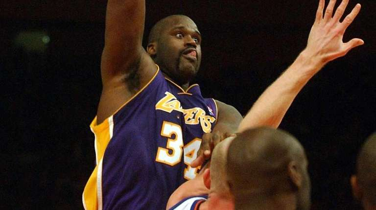 The Lakers' Shaquille O'Neal goes in for the