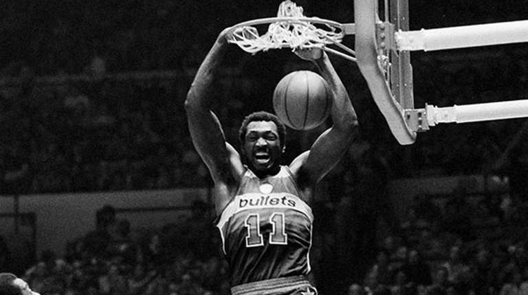 The Washington Bullets' Elvin Hayes dunks the ball