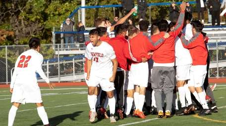The Newfield boys soccer team celebrates after beating