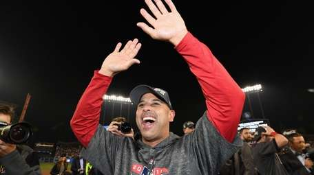 Boston manager Alex Cora received lengthy praise from