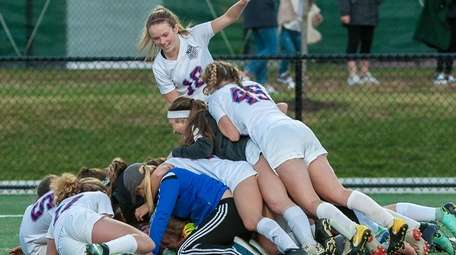 Mattituck players celebrate after beating Babylon in the