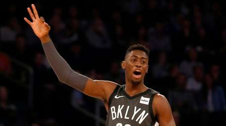 The Nets' Caris LeVert reacts after teammate D'Angelo