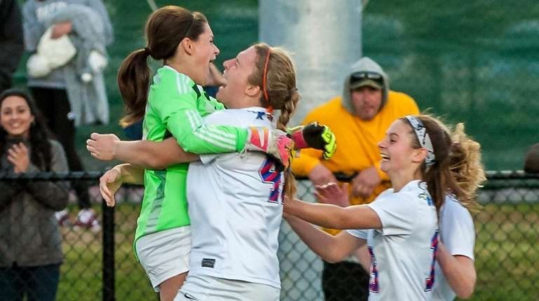 Mattituck goalkeeper Sarah Santacrouce and Jillian Golden (45)