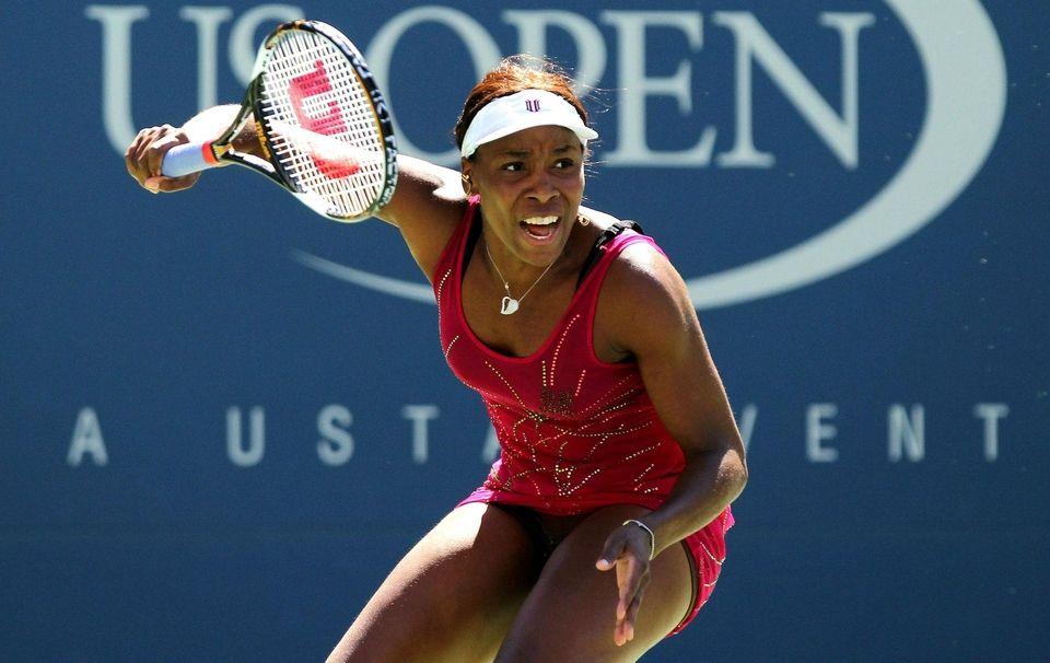Venus Williams returns a shot against Shahar Peer