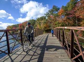 A bicyclist crosses over the waterway at Massapequa