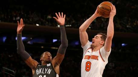 The Knicks' Mario Hezonja attempts a shot in