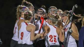 Emily Allingham #28 of Sachem East is congratulated
