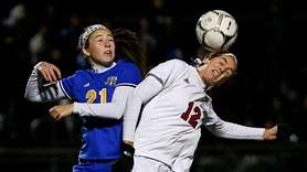 Kendall Halpern #12 of Syosset heads the ball