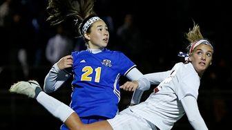 Kendall Halpern #12 of Syosset heads the ball