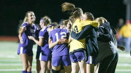Islip girls soccer team players celebrate their win