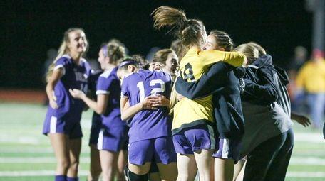 Islip girls soccer team players celebrate their win