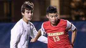 Chaminade's Jose Pena shoots and scores as Philip