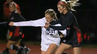 Smithtown West's Natalie Sancilio (28) and Hall Hollow