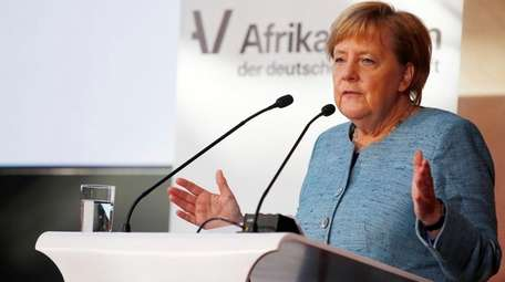 German Chancellor Angela Merkel delivers a speech during