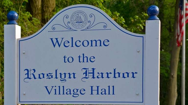 The Roslyn Harbor Village Hall sign is shown