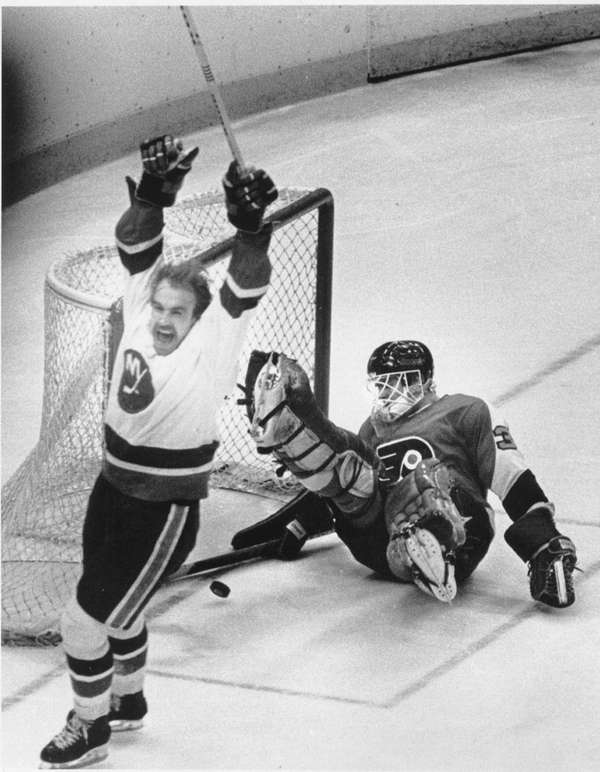 Bobby Nystrom of the Islanders exhalts after he
