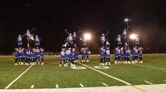 Herricks High School cheerleaders perform during homecoming on