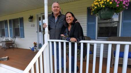 Bryan and Helen Savage on their front porch.