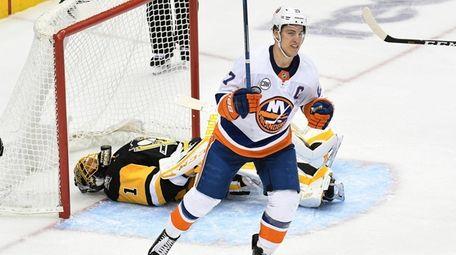 The Islanders' Anders Lee celebrates after Tom Kuhnhackl