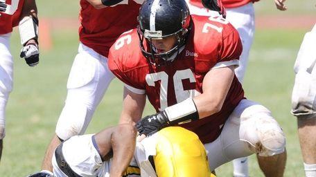 Syosset's Evan Kappalos makes a tackle during his