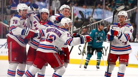 The Rangers' Kevin Shattenkirk is congratulated after scoring