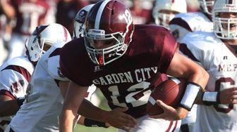 Garden City H.S. quarterback Tom Gordon, no. 12,