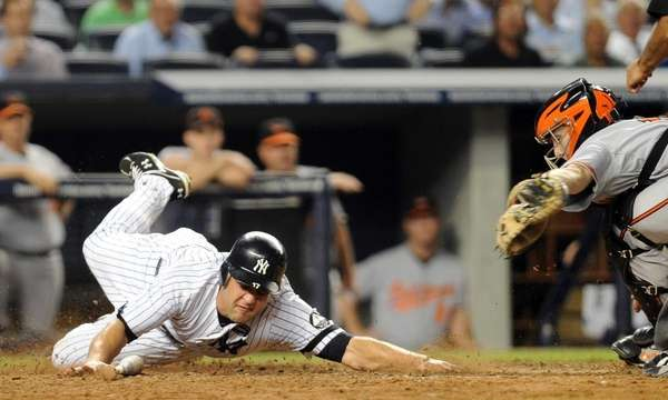 New York Yankees' Lance Berkman (17) slides around