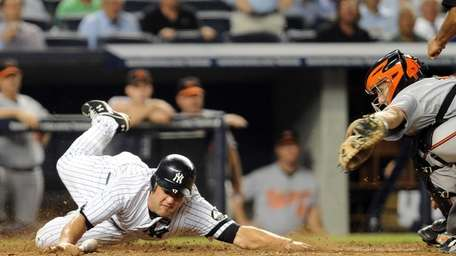 New York Yankees' Lance Berkman (17) slides around
