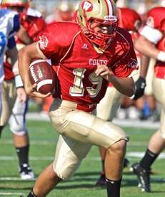 Hills West quarterback Chris Busuttil #15, runs in